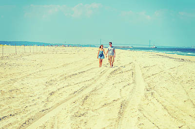 Photograph - Young American Couple Walking, Relaxing On The Beach In New Jers by Alexander Image