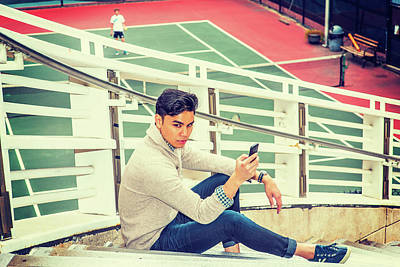 Photograph - Young Asian American Man Texting On Cell Phone Outside In New Yo by Alexander Image