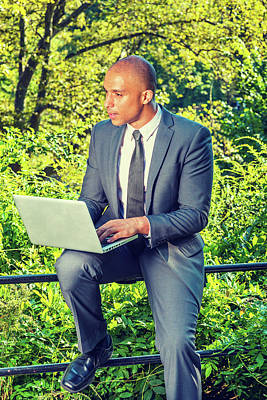 Photograph - Young Businessman Working On Computer Outside by Alexander Image