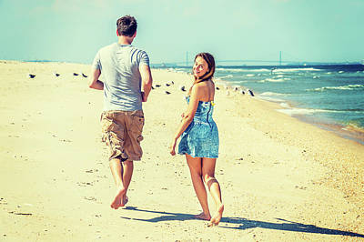 Photograph - Young Couple Running On Sandy Hook Beach, New Jersey, Usa. by Alexander Image