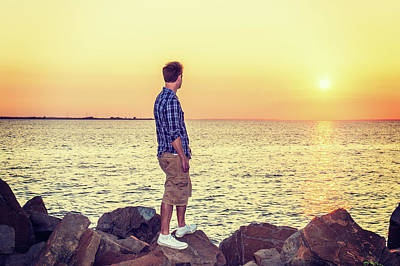 Photograph - Young Man Watching Sunset by Alexander Image