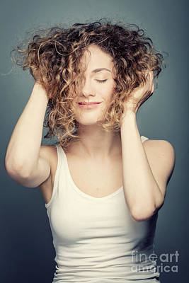 Smiling Photograph - Young Smiling Woman Holding Her Curly Hair Up. by Michal Bednarek