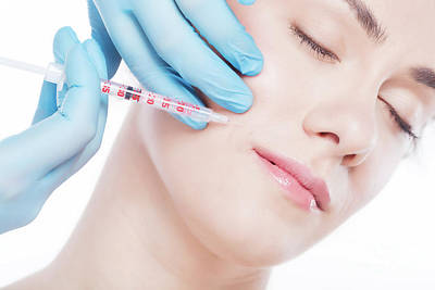 Photograph - Young Woman Having Botox Face Injections. by Michal Bednarek