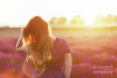 Photograph - Young Woman Touching Her Long Sombre Hair Looking At Lavender Field At Sunset by Michal Bednarek