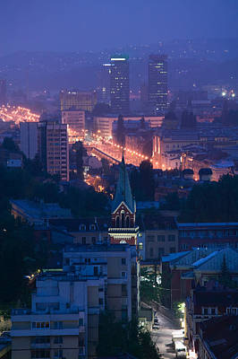 Sarajevo Photograph - Buildings Lit Up At Night In A City by Panoramic Images
