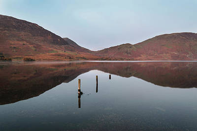 Bath Time Rights Managed Images - Beautiful Autumn Fall landscape image of Crummock Water at sunri Royalty-Free Image by Matthew Gibson