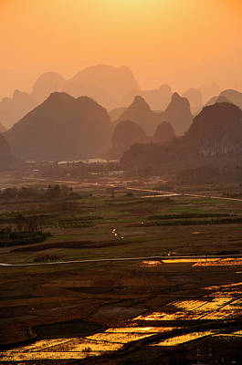 Photograph - Karst Mountains Scenery In Sunset by Carl Ning