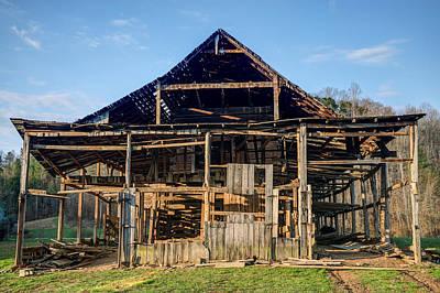 Dismantled Photograph - 1800s Barn Being Dismantled by Douglas Barnett