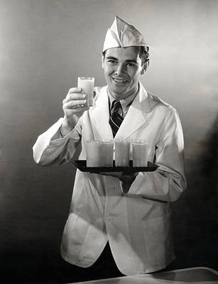 Photograph - 1940 Soda Jerk Serving Drinks by Historic Image