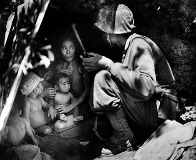 Photograph - 1944 Us Marine Assists Saipan Family by Historic Image