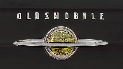 Photograph - 1950 Oldsmobile Ringed Globe Emblem by Susan Rissi Tregoning