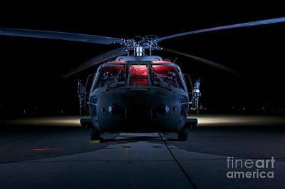 Tikrit Photograph - A Uh-60 Black Hawk Helicopter Lit by Terry Moore