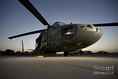 A Uh-60l Blackhawk Parked On Its Pad Art Print by Terry Moore