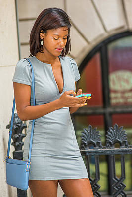 Photograph - African American Businesswoman Texting Outside Office In New Yor by Alexander Image
