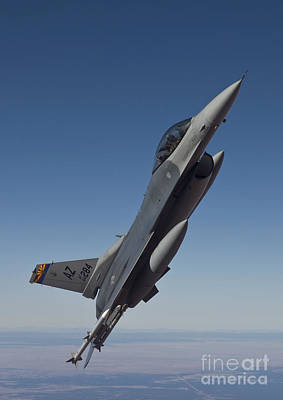 F-16 Wall Art - Photograph - An F-16 Fighting Falcon Maneuvers by HIGH-G Productions