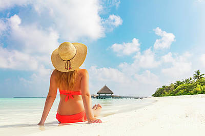 Photograph - Beautiful Young Woman In Sunhat Sitting Relaxed On Tropical Beach In Maldives by Michal Bednarek