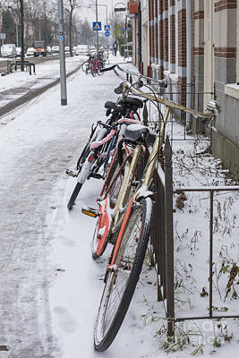 Photograph - Bikes In The Snow by Patricia Hofmeester