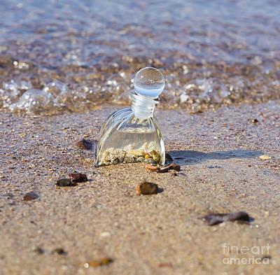 Bottle With Seashells On The Beach  Art Print by Mark Bespalov