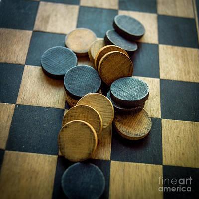 Board Game Photograph - Checkers On A Checkerboard by Bernard Jaubert