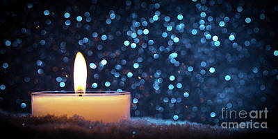Photograph - Chistmas Candle Glowing On Glitter Background. by Michal Bednarek