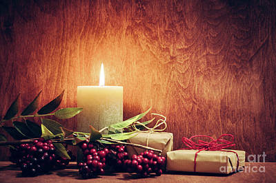 Old Plank Tables Photograph - Chistmas Presents, Gifts With A Candle Glowing On Wooden Wall Background. by Michal Bednarek