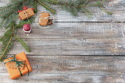 Photograph - Christmas Decorations On A Wooden Background, Top View With Copy by Julian Popov