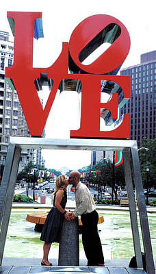 Photograph - Couple Kissing Under Love Sculpture by Carl Purcell