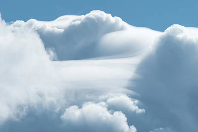 Achieving - Dramatic white clouds on a sunny day by Stefan Rotter