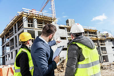Photograph - Engineers And Investor Meeting At The Construction Site. by Michal Bednarek