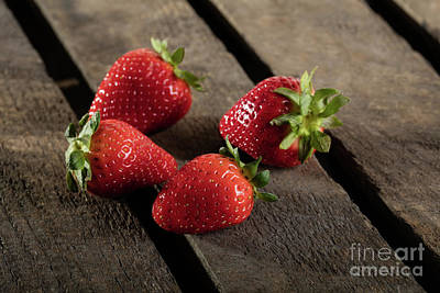 Four Juicy Strawberry On Wooden Plank Art Print