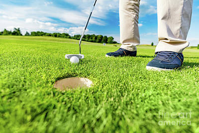 Shoe Photograph - Golfer Putting Ball In The Hole On A Golf Course. by Michal Bednarek