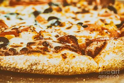 Italian Pizza With Mozzarella, Prosciutto, Tomatoes And Olives Art Print by Radu Bercan