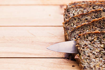 Bakery Photograph - Knife In Wholemeal Bread On Wooden Table by Michal Bednarek