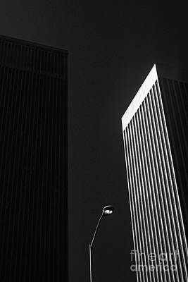 Photograph - Lamp Post Between Two Buildings by Jim Corwin
