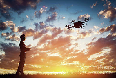 Professional Photograph - Man Operating A Drone At Sunset. by Michal Bednarek