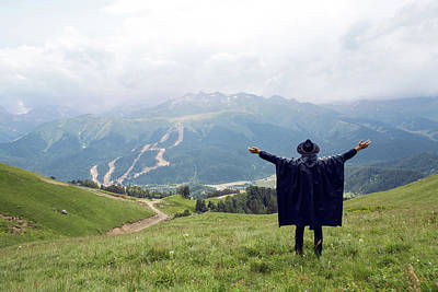 Amy Weiss - Man With A Beard Shepherd Standing In The Mountains In A Black Raincoat by Elena Saulich