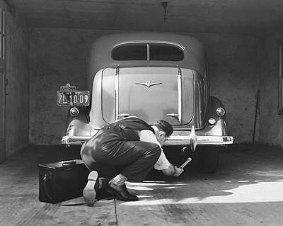 Man Working On His Car Art Print by Underwood Archives