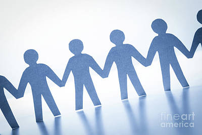 Cooperation Photograph - Paper People Standing Together Hand In Hand. Team, Society, Business Concept by Michal Bednarek