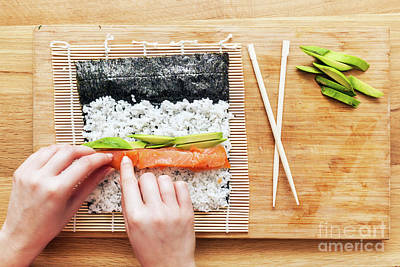 Meal Photograph - Preparing Sushi. Salmon, Avocado, Rice And Chopsticks On Wooden Table by Michal Bednarek