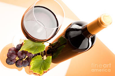 Wine Photograph - Red Wine In Glass With Bottle And Wine Grapes by Wolfgang Steiner