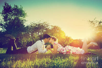 Romantic Couple In Love Kissing While Lying On Grass Print by Michal Bednarek