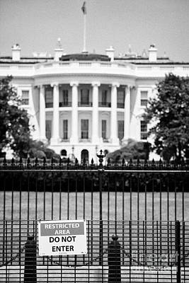 Whitehouse Wall Art - Photograph - security fence and restricted area signs at the south facade of the white house Washington DC USA by Joe Fox