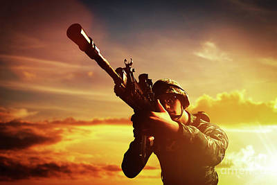 Photograph - Soldier In Combat Shooting With His Weapon, Rifle. War, Army Concept by Michal Bednarek