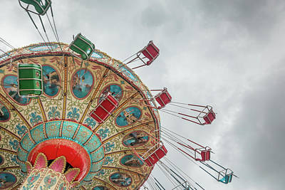 Swings In Motion With Stormy Sky Art Print by Erin Cadigan