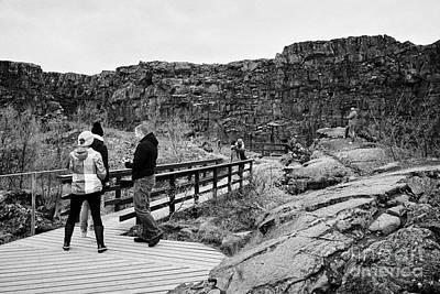 tourists walk through the Almannagja fault line in the mid-atlantic ridge north american plate Art Print