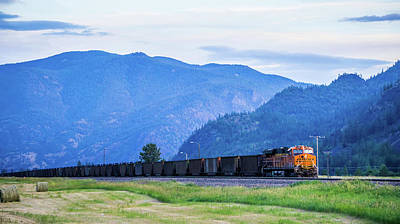 Photograph - Train Moving Through Flathead Reservation In Montana Mountains by Alex Grichenko
