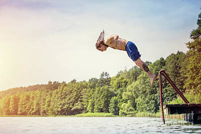 Photograph - Young Fit Man Jumping Into A Lake by Michal Bednarek