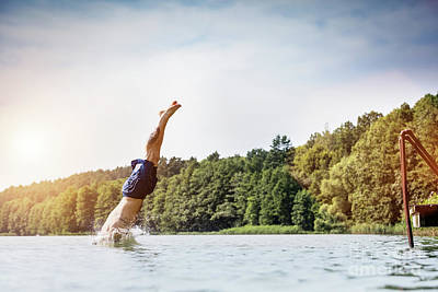 Photograph - Young Man Diving Into A Lake. by Michal Bednarek