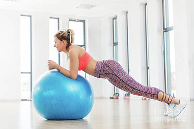 Photograph - Young Woman Training With Fitball At Fitness Club. by Michal Bednarek
