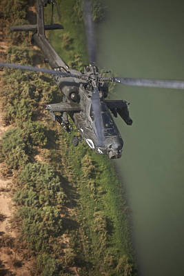 An Ah-64d Apache Helicopter In Flight Art Print by Terry Moore